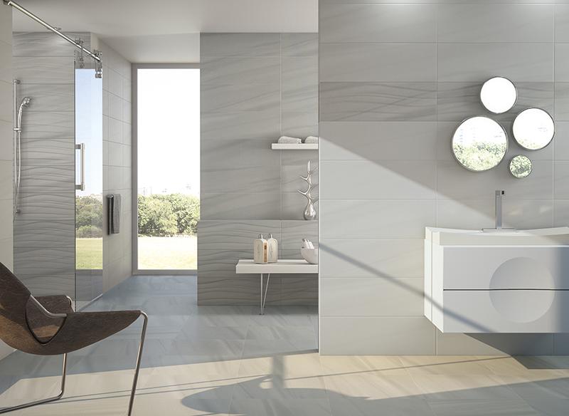 Hemos decidido renovar nuestro cuarto de baño y no tenemos claro que colores combinar en los azulejos. El gris es un color neutro que nos permite muchas posibilidades. Podemos jugar con los matices: más claro, más oscuro... y tambien con los tonos: calidos, fríos...  Hoy os traemos estas ideas de nuestro catálogo de azulejos y pavimentos con un protagonista: el color gris como base para la decoración.