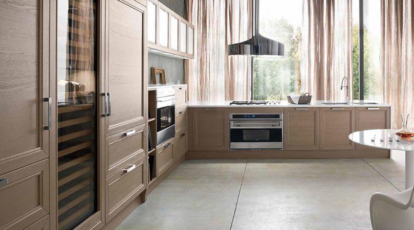 Una cocina con efecto madera en los muebles. Calidez y encanto.